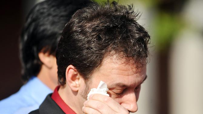Paul Kevin Curtis, who had been in custody under suspicion of sending ricin-laced letters to President Barack Obama and others, wipes a tear from his eyes during a news conference following his release Tuesday, April 23, 2013 in in Oxford, Miss. The charges were dismissed without prejudice, which means they could be re-instated if prosecutors so choose. (AP Photo/Oxford Eagle, Bruce Newman)