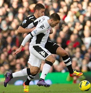 Fulham's Clint Dempsey, front, fights for the ball with Newcastle United's Danny Guthrie during their English Premier League soccer match at the Craven Cottage ground in London, Saturday, Jan. 21, 2012. (AP Photo/Bogdan Maran)