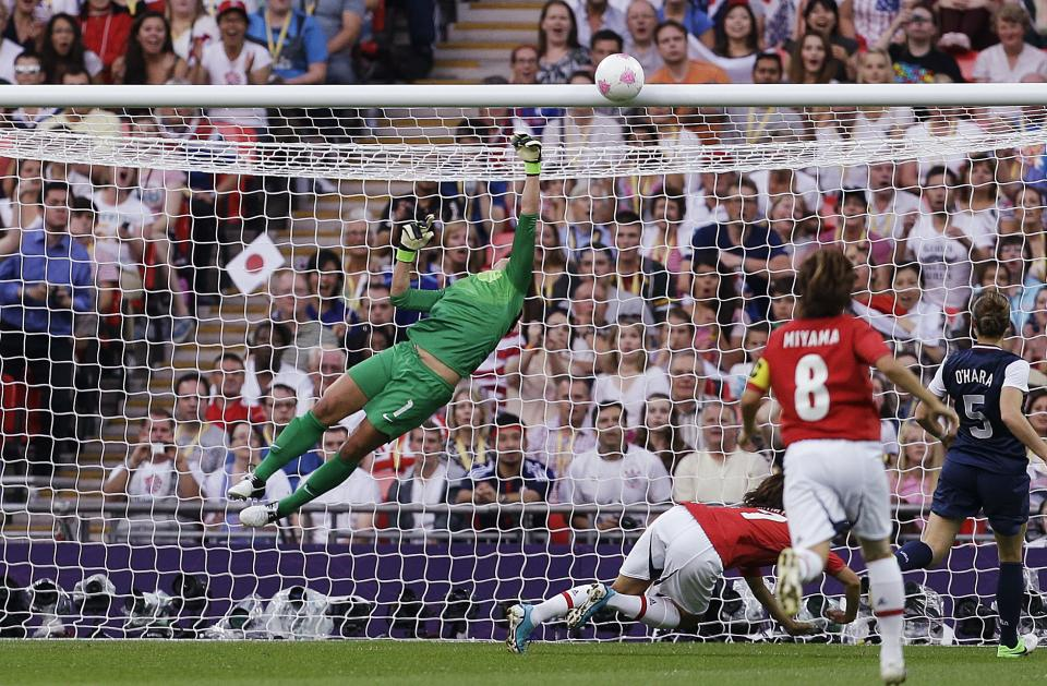 United States goalkeeper Hope Solo (1) makes a save against Japan during the women's soccer gold medal match at the 2012 Summer Olympics, Thursday, Aug. 9, 2012, in London. (AP Photo/Ben Curtis)