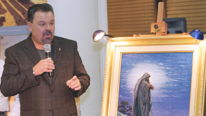 """FILE - In this Sept. 15, 2006 file photo, artist Thomas Kinkade unveils his painting, """"Prayer For Peace,"""" at the opening of the exhibit """"From Abraham to Jesus,"""" in Atlanta.  Kinkade, 54, the self-described """"Painter of Light,"""" died April 6 at his home in Los Gatos, Calif. (AP Photo/Gene Blythe, File)"""