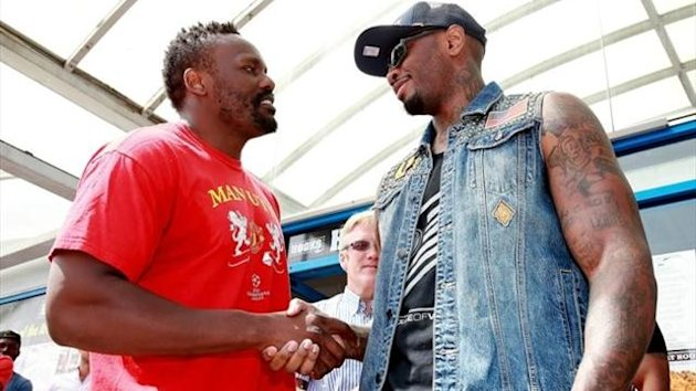 Dereck Chisora (L) and Malik Scott meet head to head during a media workout at Hooks Gym in London on July 16, 2013 in London, England. (Photo by Scott Heavey/Getty Images)