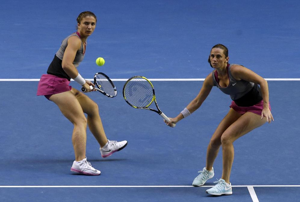 Italy's Sara Errani, left, and Roberta Vinci, right, play Russia's Ekaterina Makarova and Elena Vesnina in their women's doubles final at the Australian Open tennis championship in Melbourne, Australia, Friday, Jan. 24, 2014