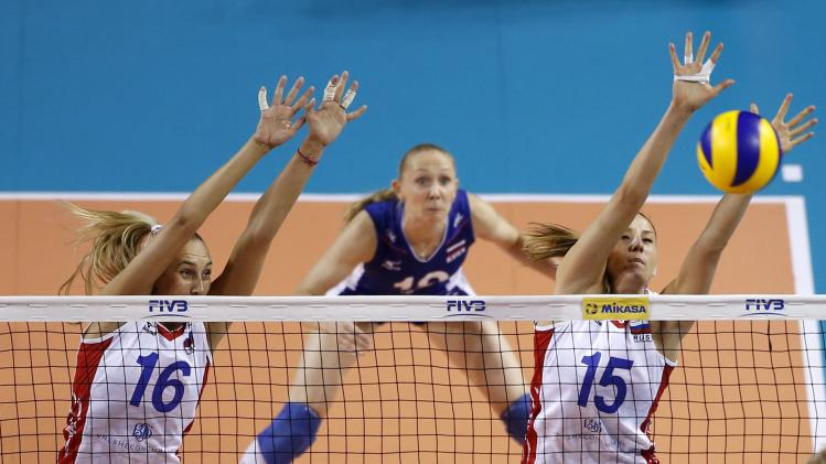 Podskalnaya and Kosheleva of Russia jump to block the ball from Belgium during their FIVB Women's Volleyball World Grand Prix 2014 final round match in Tokyo