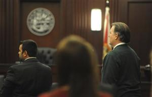 Michael Dunn who faces first-degree murder charges in the death of 17-year-old Jordan Davis stands with his attorney Cory Strolla at Duval County Courthouse in Jacksonville