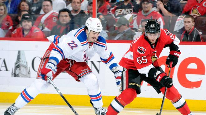 Erik Karlsson #65 Of The Ottawa Senators Skates With The Puck While Being Chased By Brian Boyle #22 Of The New York Getty Images