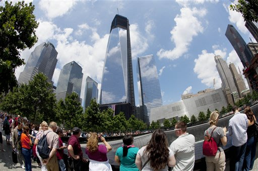 Visitors to the National September 11 Memorial get a view of One World Trade Center, center, Thursday, June 14, 2012 in New York. President Barack Obama is scheduled to visit the site later Thursday.