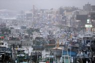 Fishing boats are moored in a shelter at Nanfangao harbor in eastern Ilan county, as typhoon Saola approches Taiwan&#39;s east coast on August 2, 2012. Saola -- the first typhoon to hit the island this year -- triggered heavy rains especially in the north and east and touched off widespread mudslides, forcing the authorities to evacuate more than 1,500 people islandwide