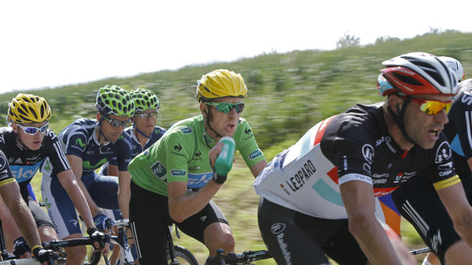 Bradley Wiggings of Britain, wearing the best sprinter's green jersey, drinks as he rides in the pack during the first stage of the Tour de France cycling race over 198 kilometers (123 miles) with start in Liege and finish in Seraing, Belgium, Sunday July 1, 2012. (AP Photo/Laurent Cipriani)