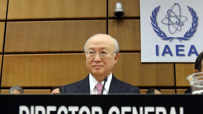 Director General of the International Atomic Energy Agency, IAEA, Yukiya Amano of Japan waits for the start of the IAEA board of governors meeting at the International Center in Vienna, Austria, Thursday, Nov. 28, 2013. (AP Photo/Ronald Zak)