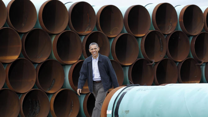 FILE - This March 22, 2012 file photo shows President Barack Obama arriving at the TransCanada Stillwater Pipe Yard in Cushing, Okla. Embarking on a second term, Obama faces mounting pressure on a decision he had put off during his re-election campaign: whether to approve the $7 billion proposed Keystone XL oil pipeline between the U.S. and Canada. (AP Photo/Pablo Martinez Monsivais, File)