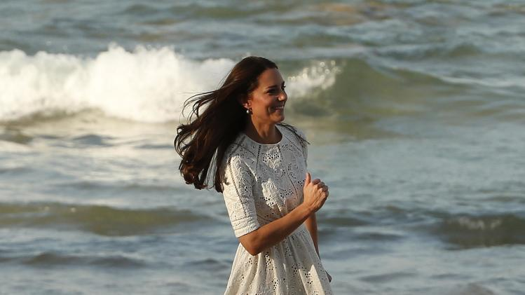 Catherine, Britain's Duchess of Cambridge, runs across Manly beach in Sydney