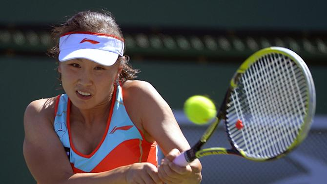 Peng Shuai, of China, returns a shot against Samantha Stosur, of Australia, during their match at the BNP Paribas Open tennis tournament, Monday, March 11, 2013, in Indian Wells, Calif. (AP Photo/Mark J. Terrill)