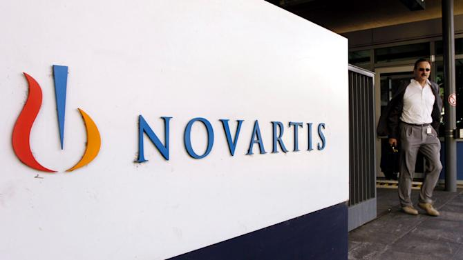 FILE - In this Aug. 12, 2005 file photo, a man passes the Logo of Swiss pharmaceutical company Novartis at the company's headquarters in Basel, Switzerland. Novartis AG reported a jump in fourth-quarter net profit to $2.08 billion Wednesday Jan. 23, 2013, citing the lack of a $900-million one-time charge it took in the same period the previous year. (AP Photo/Keystone, Steffen Schmidt, file)