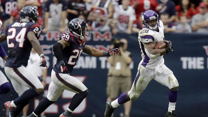 Minnesota Vikings running back Adrian Peterson (28) rushes for a gain as Houston Texans' Glover Quin (29) and Johnathan Joseph (24) defend during the third quarter of an NFL football game Sunday, Dec. 23, 2012, in Houston. (AP Photo/Patric Schneider)