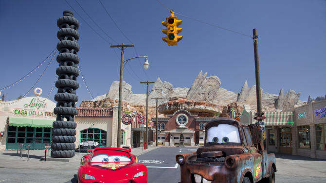 """This May 2012 photo released by Disneyland shows characters Lightning McQueen, left, and Mater at the new 12-acre Cars Land, a replica of Radiator Springs, the town in the popular """"Cars,"""" film franchise at Disney California Adventure park at Disneyland Resort in Anaheim, Calif.  The park's five-year, $1 billion-plus revamp has debuted in spurts since 2008. Most of its new features rely on characters that come from Disney's $7.4 billion acquisition of Pixar Animation Studios, the San Francisco-area studio behind """"Cars,"""" `'Toy Story,"""" `'Monsters Inc."""" and """"A Bug's Life.""""  (AP Photo/Disneyland Resort, Paul Hiffmeyer)"""