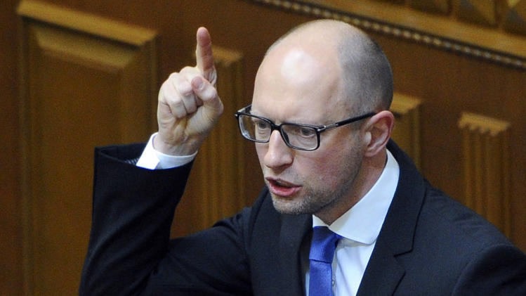 This handout picture taken and released by the Ukrainian Prime Minister Press-Service on July 24, 2014 shows Ukrainian Prime Minister Arseniy Yatsenyuk as he addresses members of parliament during a parliamentary session in Kiev