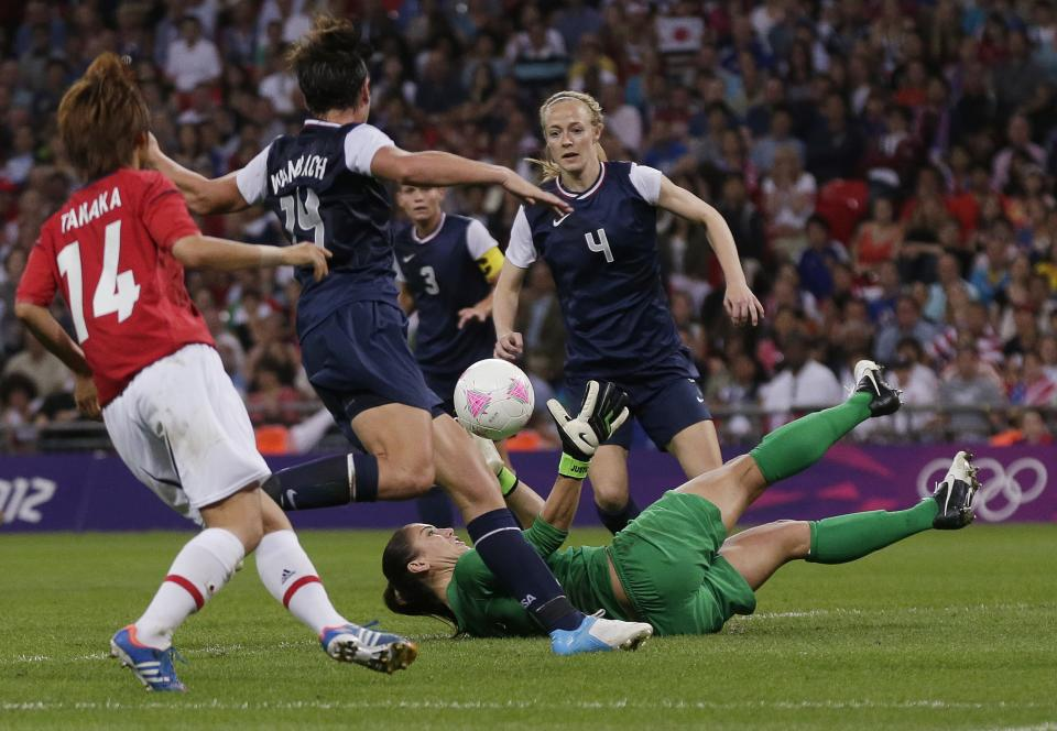 United States goalkeeper Hope Solo dives for the ball during the women's soccer gold medal match at the 2012 Summer Olympics, Thursday, Aug. 9, 2012, in London. (AP Photo/Julie Jacobson)