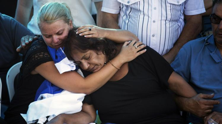 Girlfriend Yulia and mother Pnina of Israeli soldier Adi Briga who was killed on Monday by a Palestinian mortar strike from the Gaza Strip, attend his funeral in Ashkelon