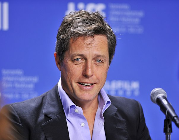 "FILE - In this Sept. 9, 2012 file photo, actor Hugh Grant speaks during the news conference for the film ""Cloud Atlas"" during the 2012 Toronto International Film Festival in Toronto. Hugh Grant was among 17 hacking victims who settled Friday Feb. 8, 2013 with News Corp. subsidiary News Group Newspapers over its campaign of illegal espionage, which set off a massive scandal when it was revealed in July 2011. (AP Photo/The Canadian Press, Aaron Vincent Elkaim, File)"