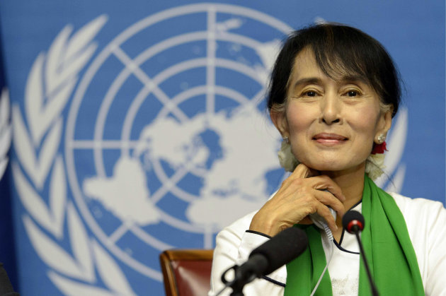 Myanmar opposition leader Aung San Suu Kyi attends a news conference during the annual meeting of the International Labour Organization (ILO) in Geneva, Switzerland, Thursday, June 14, 2012. Suu Kyi said that investment in her country should strengthen its nascent process of democratization. The Nobel peace laureate spoke Thursday to the annual meeting of the ILO in Geneva on the first stop of her trip to Europe. (AP Photo/Keystone, Laurent Gillieron)