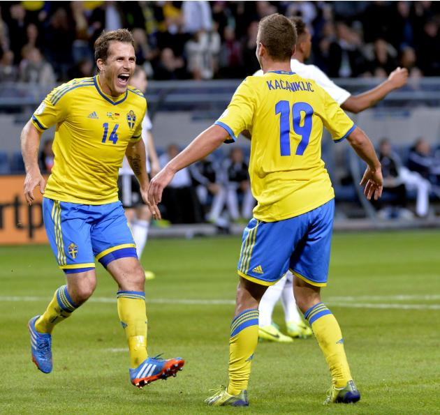 Sweden's Alexander Kacaniklic, right, celebrates with teammate Tobias Hysen, left, after scoring his team's second goal during the 2014 World Cup group C qualifying soccer match between Sweden and Ger