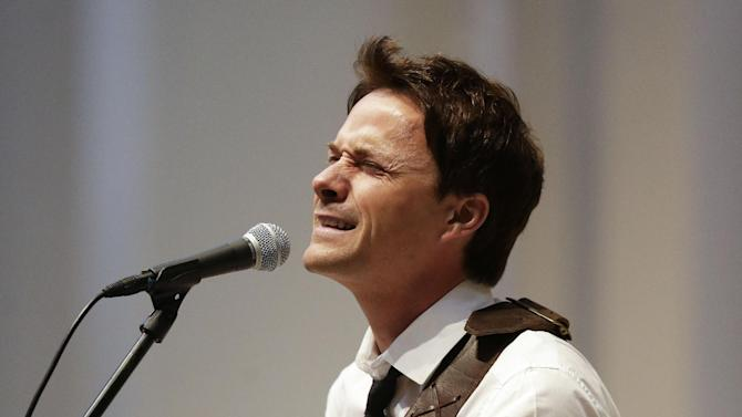 Bryan White performs during a memorial service for fellow country singer Mindy McCready on Wednesday, March 6, 2013, in Nashville, Tenn. McCready committed suicide Feb. 17 in Heber Springs, Ark. (AP Photo/Mark Humphrey)