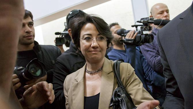 FILE - In this Dec. 27, 2012 file photo Israeli Arab parliament member Hanin Zoabi arrives for a hearing about her disqualification from politics at Israel's Supreme Court, in Jerusalem. Israel's Supreme Court on Sunday Dec. 30, 2012 unanimously rejected an election committee's attempt to disqualify Zoabi from running for parliament again next month because she took part in a flotilla that tried to breach Israel's naval blockade of the Hamas-run Gaza Strip in 2010. (AP Photo/Emil Salman, File) ISRAEL OUT