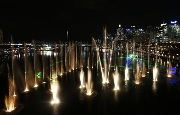 Water fountains are lighted up as part of the Aquatique Show International one night before the Vivid Festival opening night at Darling Harbour in Sydney
