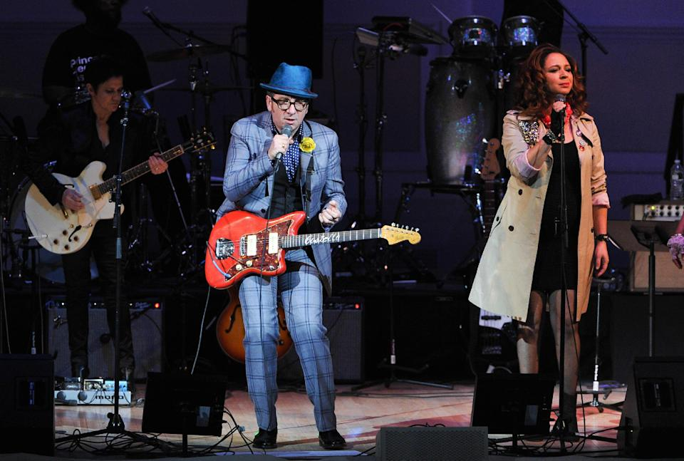 "Musician Elvis Costello, left, performs with Maya Rudolph at ""The Music of Prince"" tribute concert at Carnegie Hall on Thursday March 7, 2013 in New York. (Photo by Evan Agostini/Invision/AP)"