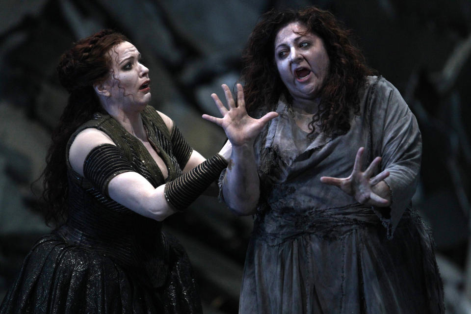 "In this photo taken Tuesday, Oct. 2, 2012, in Chicago, from left, Emily Magee as Chrysothemis, and Christine Goerke as Elektra, perform during the first act of a dress rehearsal of the Lyric Opera of Chicago's new production of ""Elektra."" (AP Photo/M. Spencer Green)"