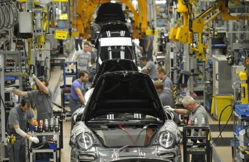 <p>The production line for Porsche 911 cars in Stuttgart, southwestern Germany. The German government is set to fractionally upgrade its growth forecast for the current year, but slash its prognosis for next year, a government source told AFP on Tuesday.</p>