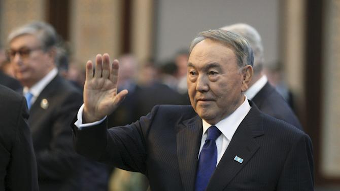 Nazarbayev waves as he arrives for his annual address to the nation in Astana