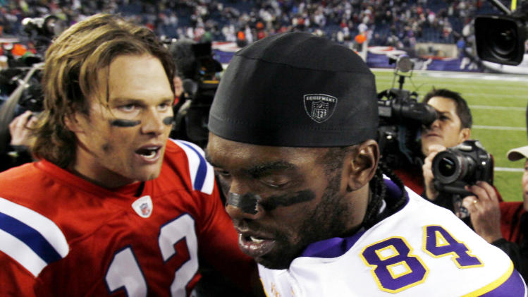 New England Patriots quarterback Tom Brady shakes hands with Minnesota Vikings wide receiver Randy Moss after New England's 28-18 win in an NFL football game in Foxborough, Mass., Sunday, Oct. 31, 2010. (AP Photo/Winslow Townson)