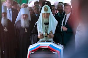 Russian Orthodox Patriarch Kirill (C) conducts a religious…