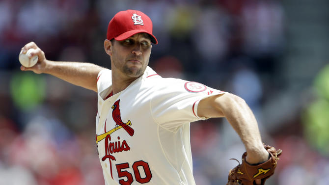 St. Louis Cardinals starting pitcher Adam Wainwright throws during the first inning of a baseball game against the Colorado Rockies, Saturday, May 11, 2013, in St. Louis. (AP Photo/Jeff Roberson)