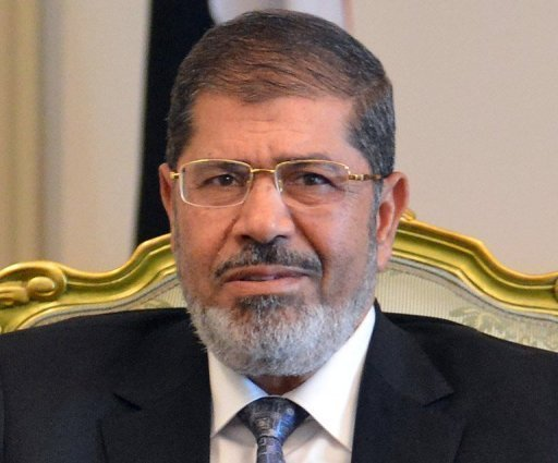 "Egypt's Islamist President Mohamed Morsi, seen here on September 4, has slammed ""attacks"" on the Muslim prophet Mohammed in a film on Islam that sparked an outcry in Egypt, while also stressing that he condemned violence"