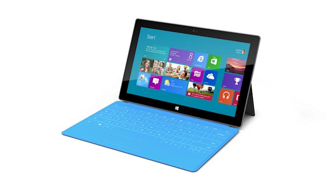 This product rendering released by Microsoft shows Surface, a 9.3 millimeter thick tablet with a kickstand to hold it upright and keyboard that is part of the device's cover. It weighs under 1.5 pounds. The device is part of the software company's effort to compete with Apple Inc. and its popular iPad tablet computer. (AP Photo/Microsoft)
