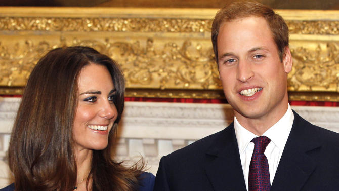 FILE - In this Nov. 16, 2010 file photo, Britain's Prince William and his fiancee Kate Middleton are seen at St. James's Palace in London, after they announced their engagement. (AP Photo/Kirsty Wigglesworth, file)