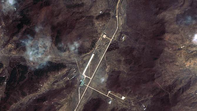 "This March 28, 2012 satellite image provided by DigitalGlobe shows North Korea's Tongchang-ri Launch Facility, including the launch pad, center left,  the rocket engine test stand, bottom, and the assembly building, top in green, on the nation's northwest coast.   An analysis of the March 28 images provided to The Associated Press by the U.S.-Korea Institute at Johns Hopkins School of Advanced International Studies shows Pyongyang ""has undertaken more extensive preparations for its planned April rocket launch than previously understood.""  The new satellite images of the North Korean rocket launch site showed a mobile radar trailer and rows of what appear to be empty fuel and oxidizer tanks, evidence of ramped up preparation for what Washington calls a cover for a long-range missile test. (AP Photo/DigitalGlobe) MANDATORY CREDIT, NO SALES"