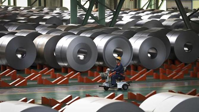 An employee works inside a steel factory in Caofeidian on the northeastern coast of China's Hebei province, October 11, 2013. REUTERS/China Daily/Files