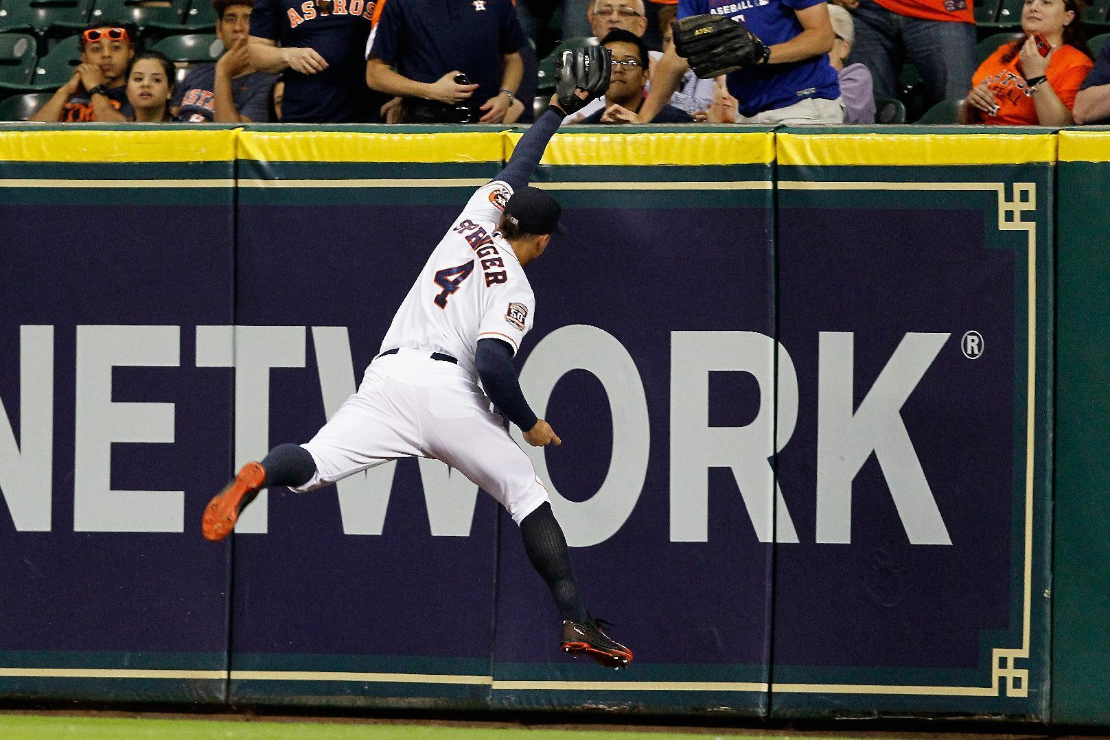George Springer makes exceptional catch while slamming into outfield wall