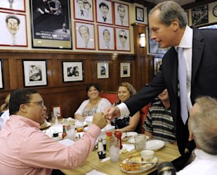 Lt. Gov. David Dewhurst, right, fist bumps Jason Carter at a deli Tuesday, July 31, 2012, in Houston. (AP Photo/Pat Sullivan)