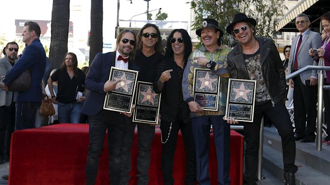Members of Mexican rock band Mana Vallin, Calleros, Gonzalez and Olvera pose with Santana by their star after it was unveiled on the Hollywood Walk of Fame in Los Angeles