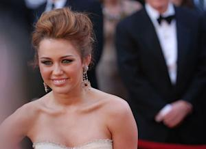 Miley Cyrus Grieves Over Loss of Dog: Other Stars to Lose Pets in 2012