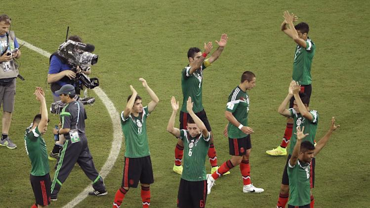Mexico wave to fans after defeating Crotia 3-1, in a the group A World Cup soccer match between Croatia and Mexico at the Arena Pernambuco in Recife, Brazil, Monday, June 23, 2014