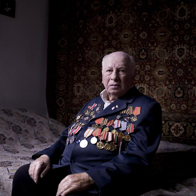 In this photo made Friday, April 12, 2013, Soviet Jewish World War veteran Matvey Gershman, 90, poses for a portrait at his house in the southern Israeli city of Ashkelon. Gershman joined the Red Army