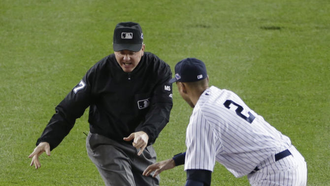 New York Yankees' Derek Jeter, right, and Baltimore Orioles' Nate McLouth watch as second base umpire Mike Everitt calls McLouth out on an attempted steal in the first inning in Game 3 of the American League division baseball series, Wednesday, Oct. 10, 2012, in New York. (AP Photo/Peter Morgan)