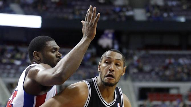 San Antonio Spurs center Boris Diaw (33) drives against Detroit Pistons forward Jason Maxiell, left, in the first half of an NBA basketball game Friday, Feb. 8, 2013, in Auburn Hills, Mich. (AP Photo/Duane Burleson)