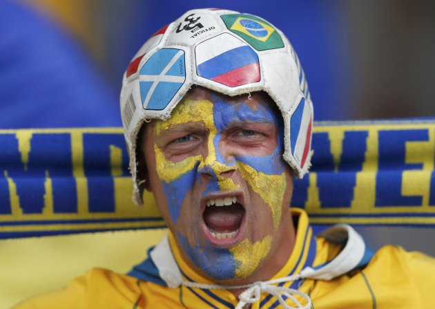 Sweden's soccer fan with painted face cheers before their Group D Euro 2012 soccer match against Ukraine at the Olympic stadium in Kiev