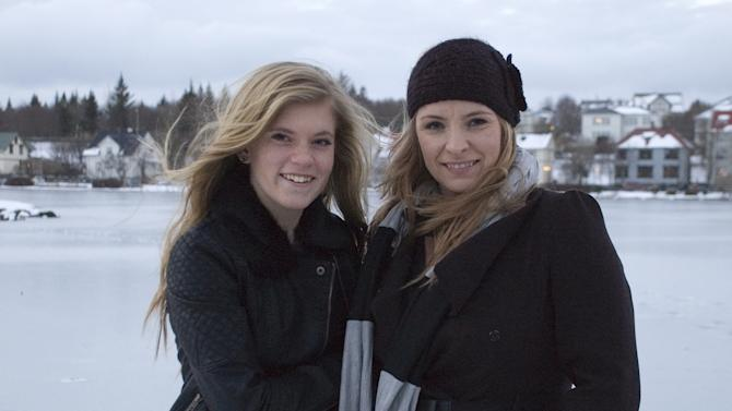 """In this Sunday, Dec. 30, 2012 photo, Blaer Bjarkardottir, 15, left, and her mother, Bjork Eidsdottir, are photographed in front of a pond in Reykjavik. Blaer Bjarkardottir is bringing legal action against the Icelandic government to allow her to use her name, which is not on the list of 1,853 government-approved female names. Blaer's mother is supporting her daughter's right to have her name recognized. She said she did not know the name wasn't on the list when she chose it for her daughter. Icelandic law requires names to comply with Icelandic grammar and orthography. The name means """"light breeze"""" in Icelandic. There are 1,712 approved male names. (AP Photo/Anna Andersen)"""